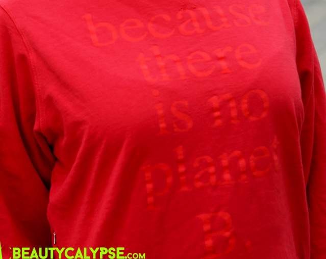 "Close-up Ecoalf print sweater: ""Because there is no planet B."""