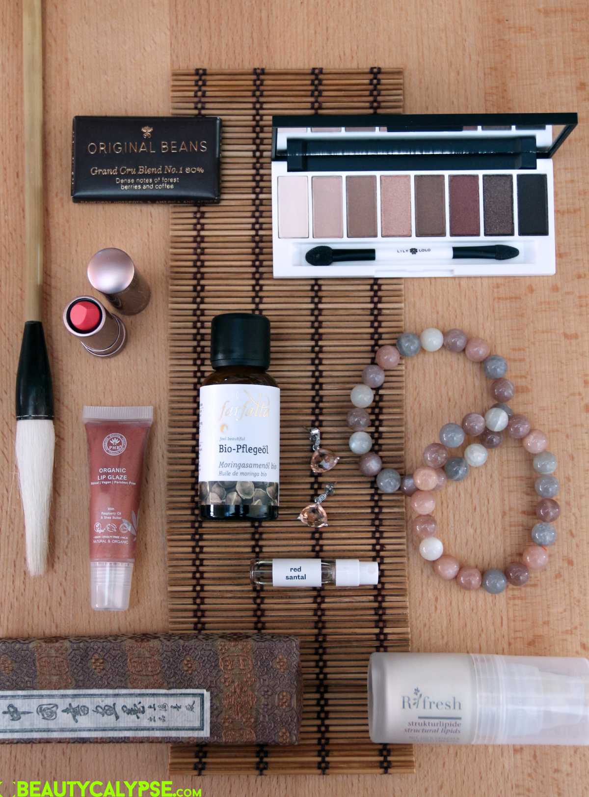 Ringana Refresh structural lipids, Farfalla Organic moringa seed oil, Lily Lolo eye shadow palette in 'pure indulgence', PHB Ethical Beauty organic lip glaze in 'Blossom', 100% Pure cacao matt lipstick in 'prickly pear'