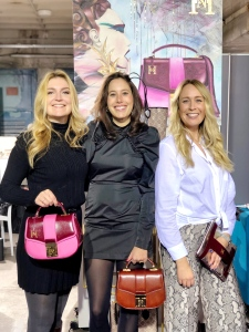 Humour.Noir: Designer Anke and founder Jennifer are sporting different styles of the Glory satchel; sales manager Jana with the metallic silver Vibe pouch.